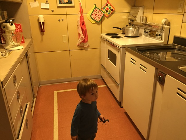 boy in the kitchen of the Lustron House