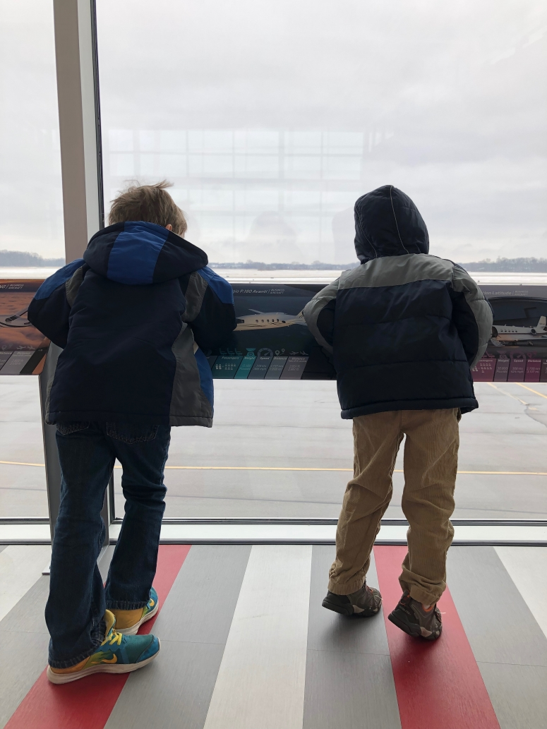 boys watching planes take off at Ohio State University Airport