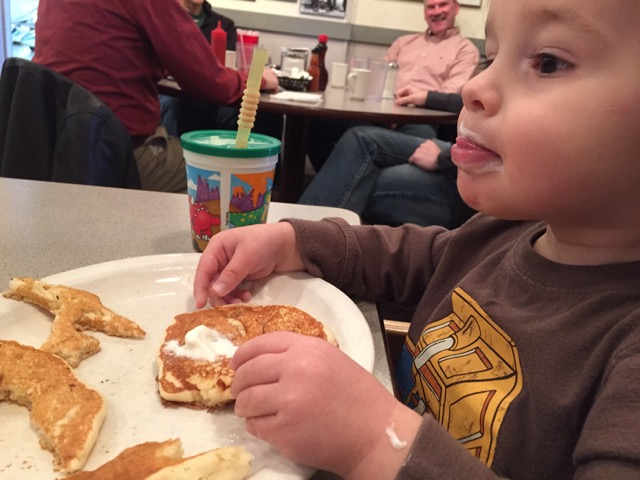 boy eating pancakes at Jack and Benny's Barnstormer Diner