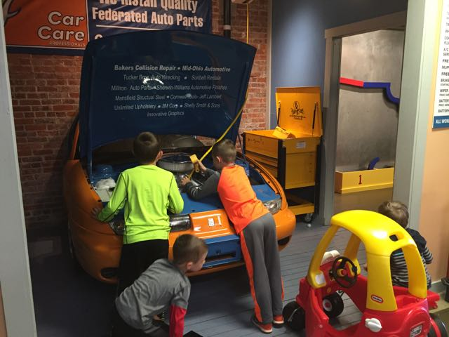kids looking at car at Little Buckeye Museum