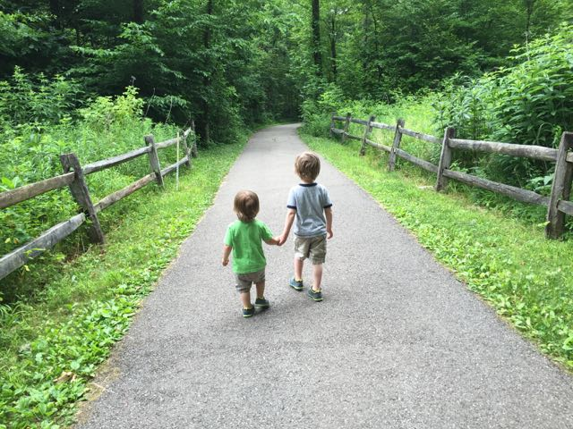 two boys walking down a path at Blendon Woods Metro Park