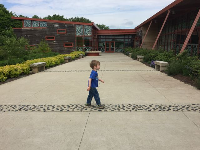 boy in front of the Nature Center