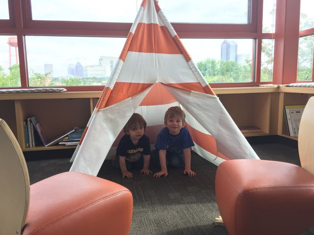 boys in a tee pee at the Nature Center