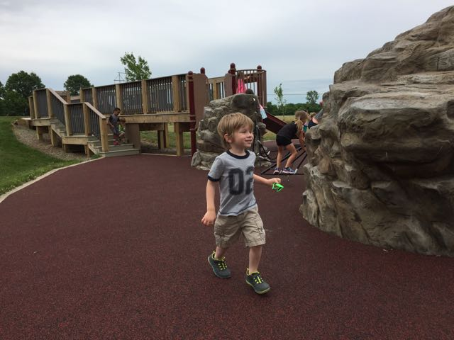 boy running on playground area at Rocky Fork Metro Park