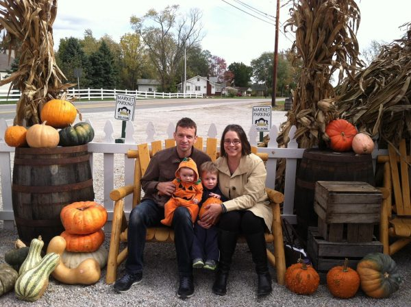 Family sitting with pumpkins at Smith Farm Market in Columbus, Ohio