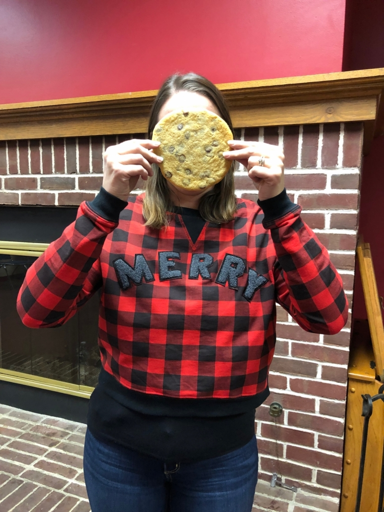 Girl holding a Face Cookie from Kittie's, a bakery in Columbus, Ohio