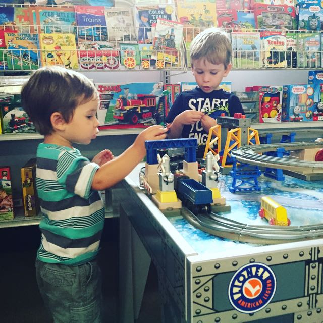 Boys playing with trains in the gift shop at Mad River and NPK Railroad Museum