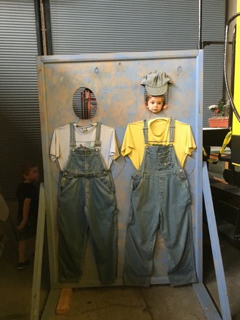 boys posing for a pictures in Engineer outfits at the Railroad Museum in Bellevue Ohio