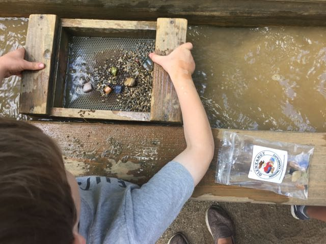 a boy mining for gems at Olentangy Indian Caverns