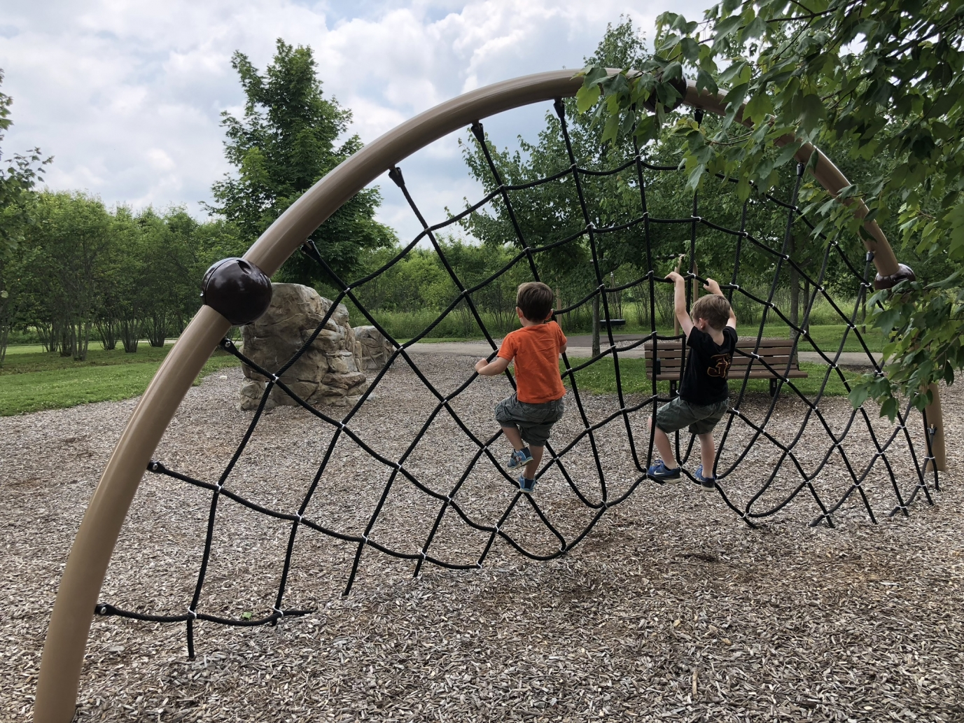 boys rope climbing at walnut woods metro park playground