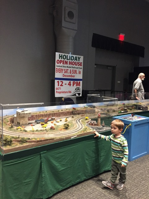 boy in front of a model railroad