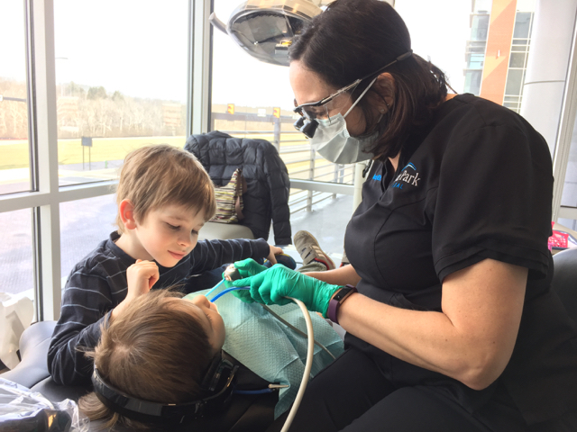 Kid getting teeth cleaned at River Park Dental