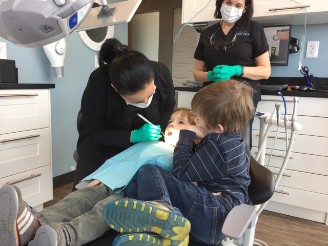 Dentist checking teeth at River Park Dental