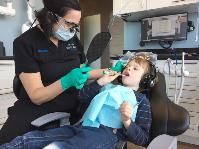 Kid brushing his teeth at River Park Dental