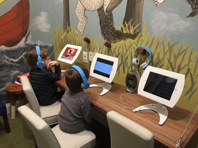 Kids on iPads at River Park Dental