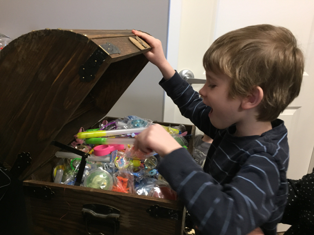 Kid picking from treasure box at River Park Dental