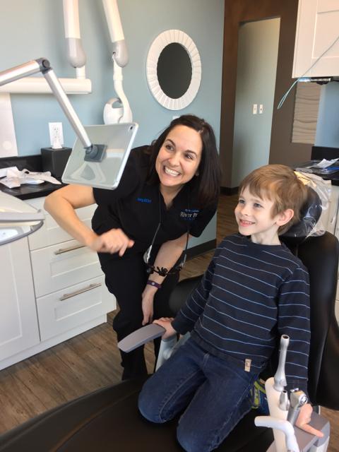 kid in dental chair at River Park Dental