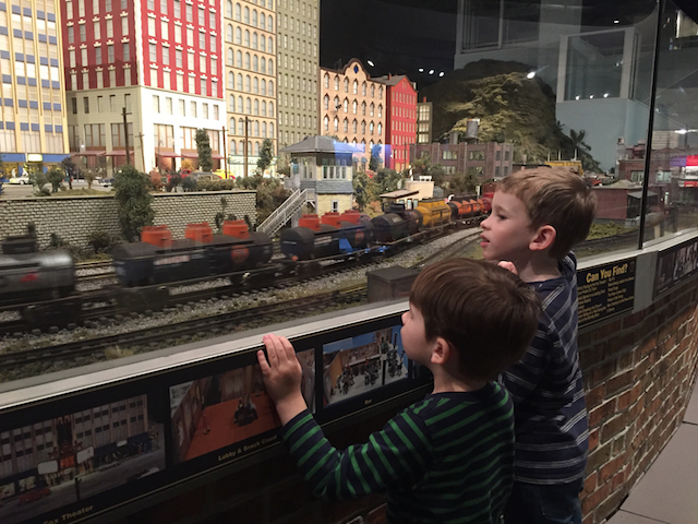 kids watching a model train