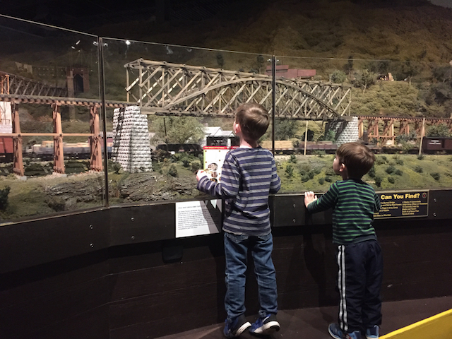 kids looking at a model train