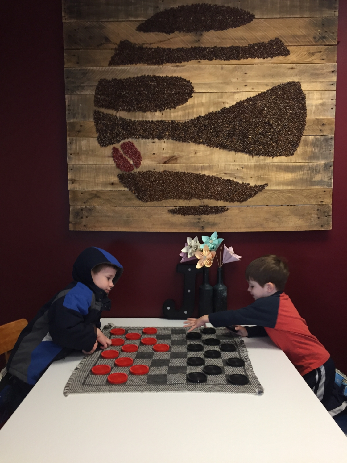 boys playing checkers at Jupiter Coffee and Donuts