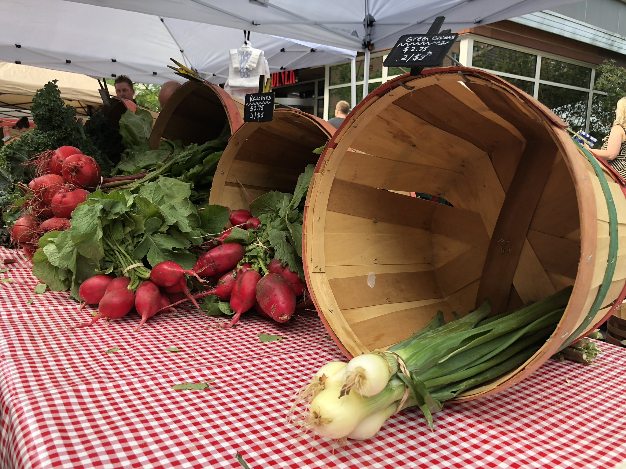 radishes and onions at a farmers market in columbus ohio