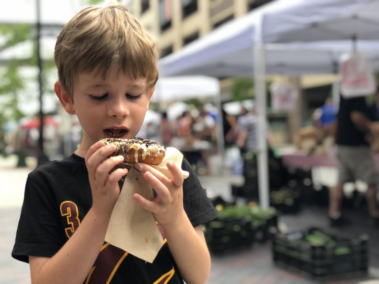 boy eating donut at the dublin market