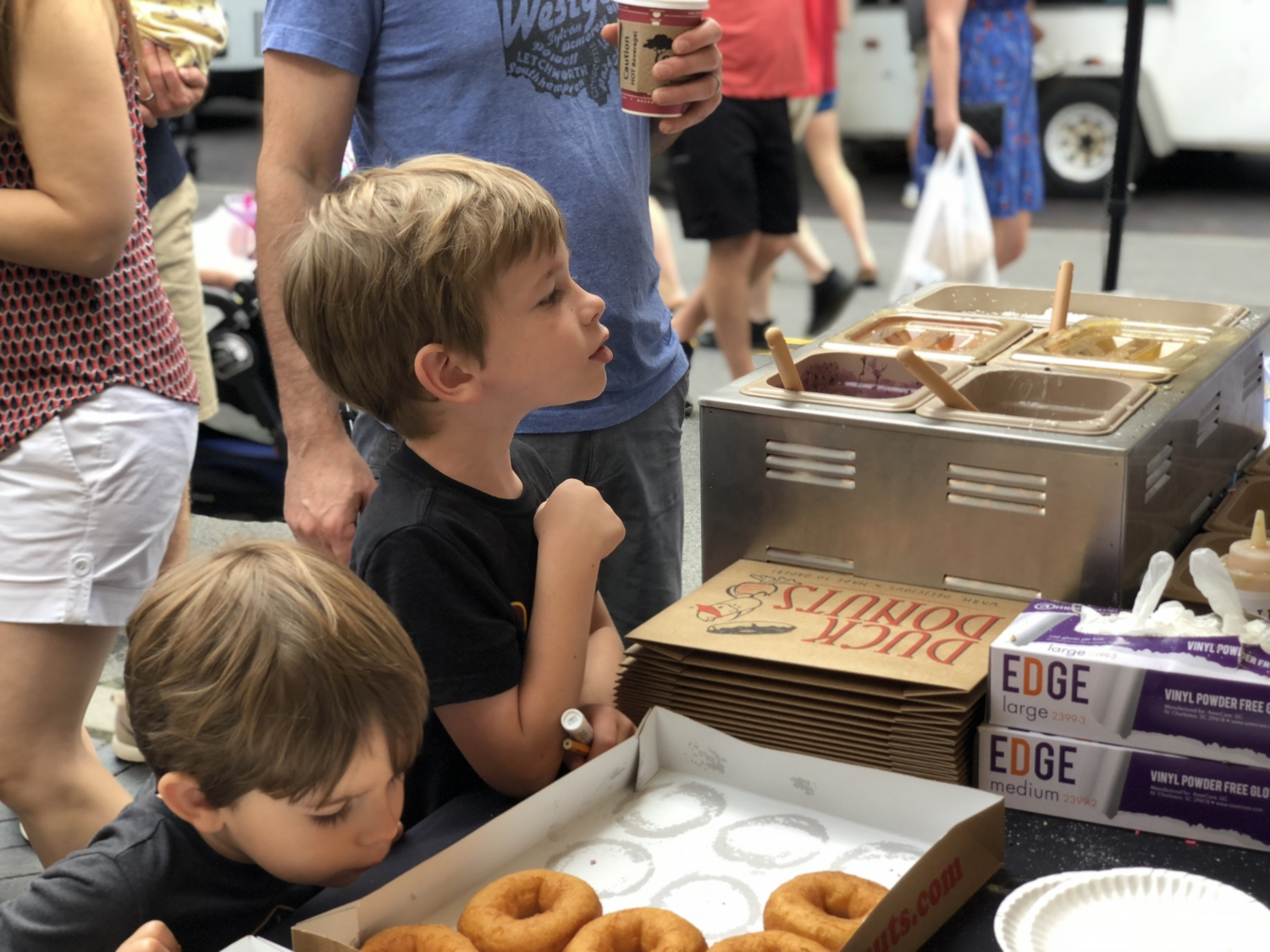 kids ordering donuts at the dublin market