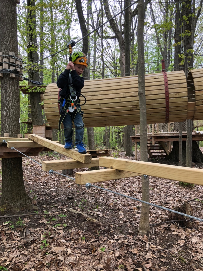kid on course at Lake Erie Canopy Tours