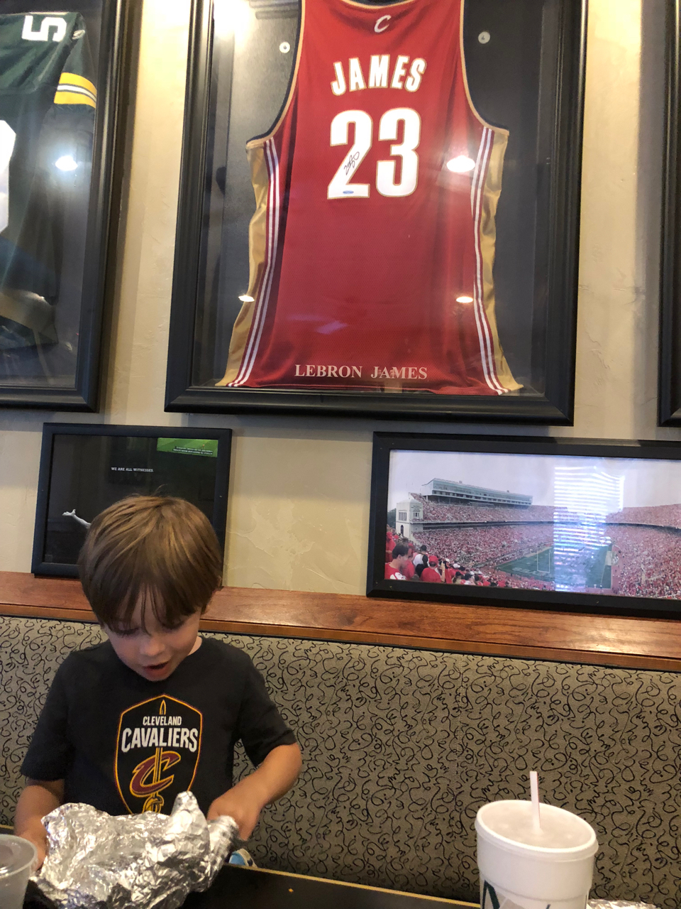Boy seated in booth at Mike and Rosy's Deli in Springfield, Ohio