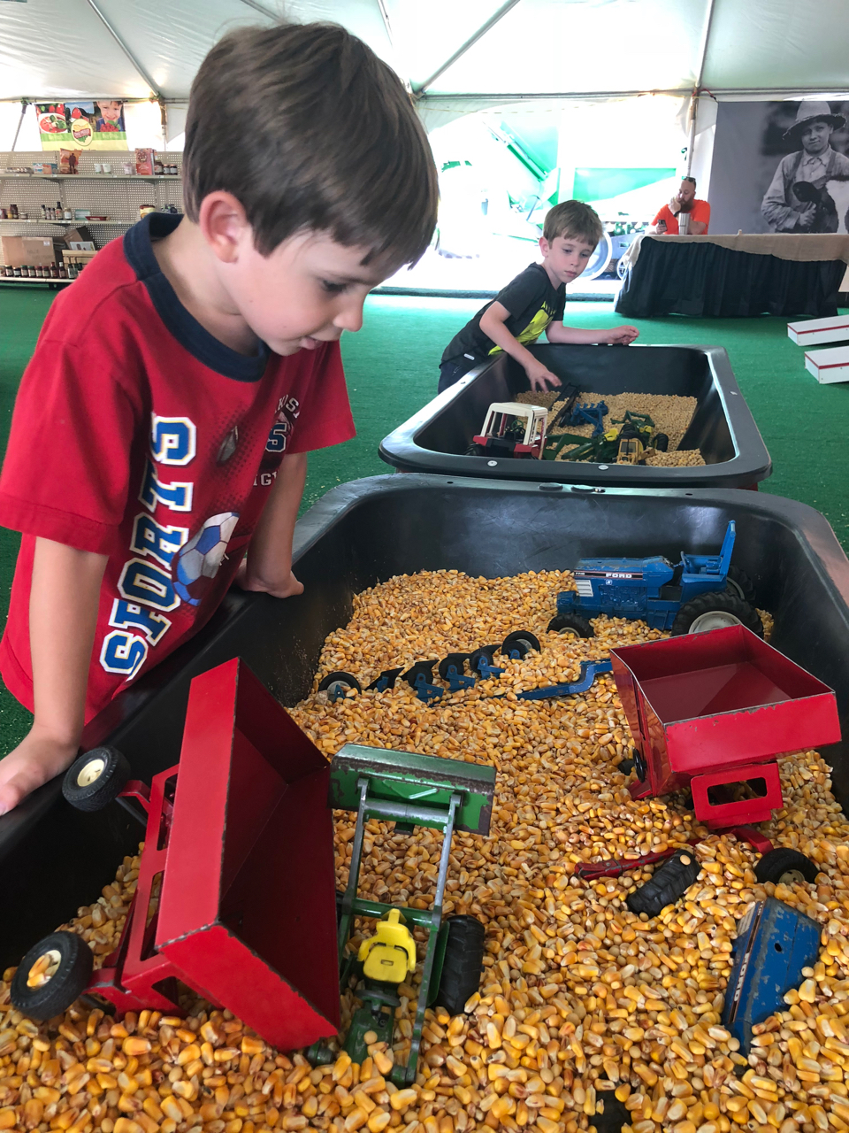 Boys playing in corn bin at Ohio State Fair