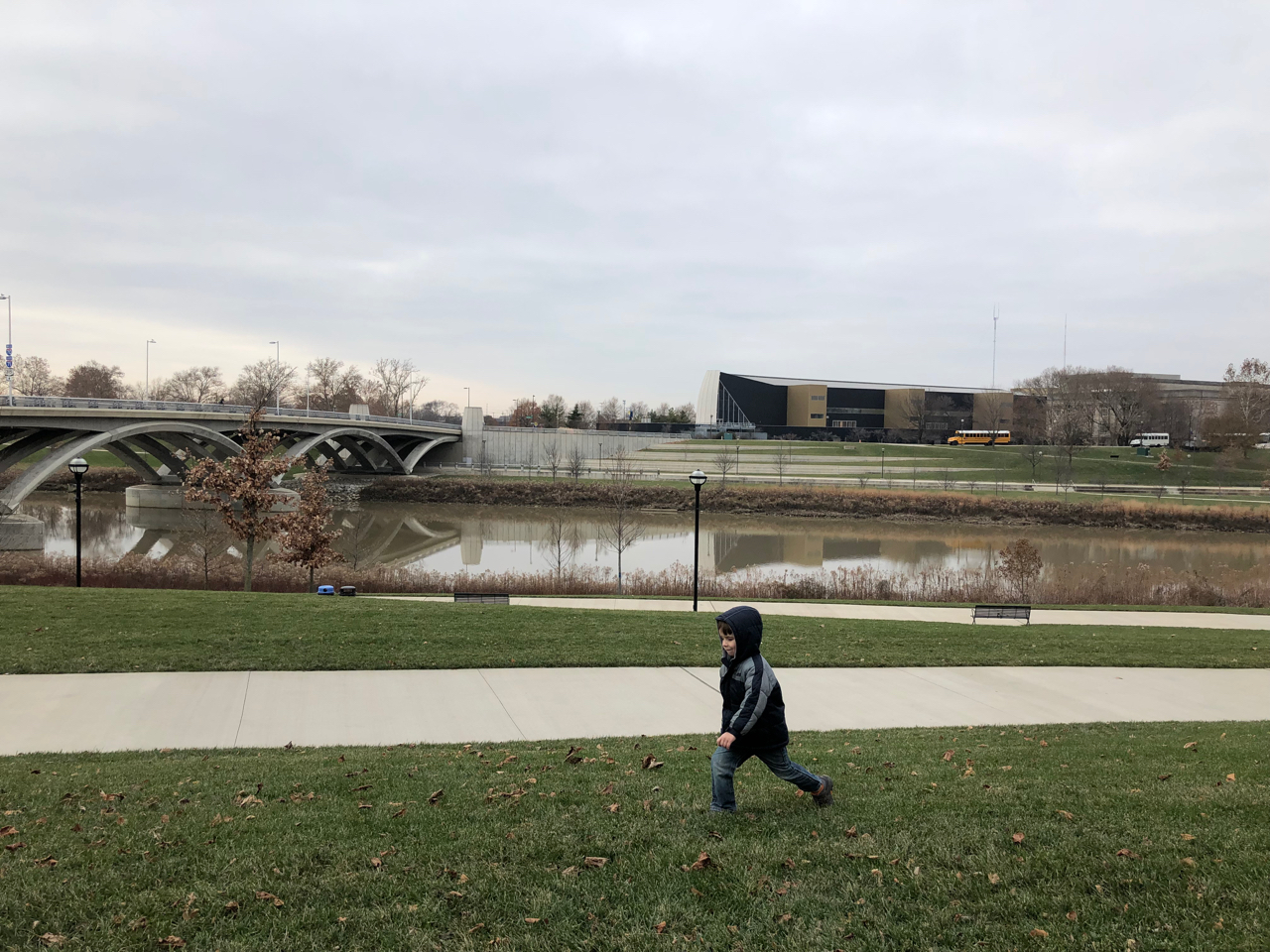 boy running on the scioto mile