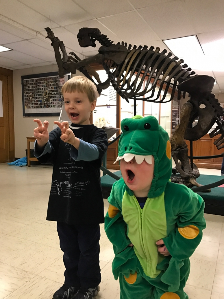 kids posing in front of dinosaur at Orton Hall, Ohio State University Campus