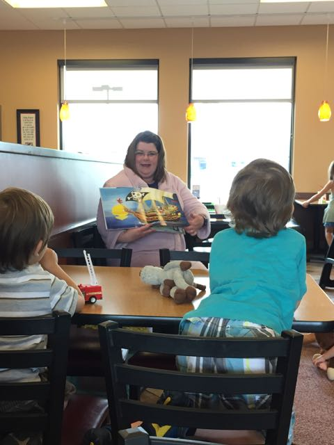 woman reading a story at chick fil a on sawmill