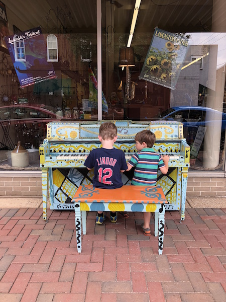 kids playing piano in downtown Lancaster, Ohio