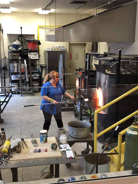 woman doing a glass blowing demonstration at Ohio Glass Museum in lancaster, Ohio