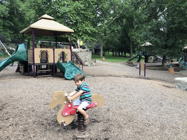 kid playing on equipment at Rising Park in Lancaster, Ohio