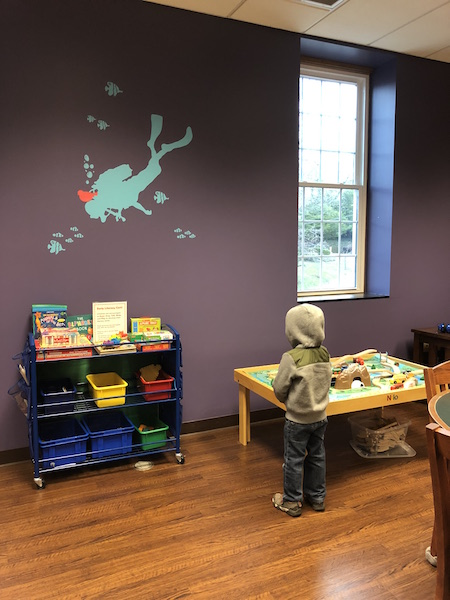 kid playing with toys at library in Lancaster, Ohio