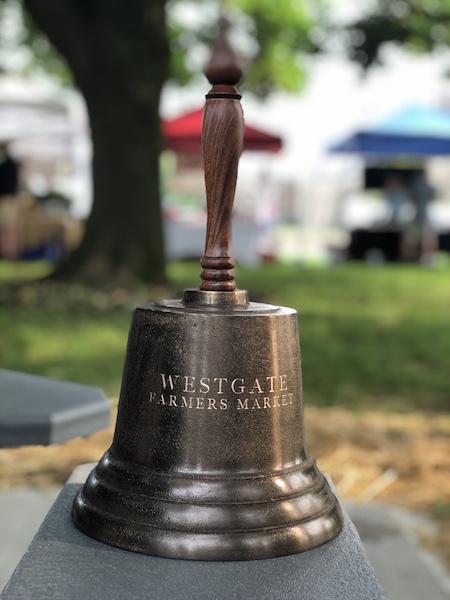 large handheld bell at the westgate farmers market in columbus ohio