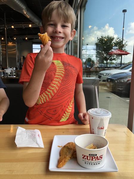 boy eating at Cafe Zupas, Easton Town Center, Columbus, Ohio