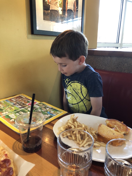 kid looking at magazine at Northstar Cafe, Easton Town Center