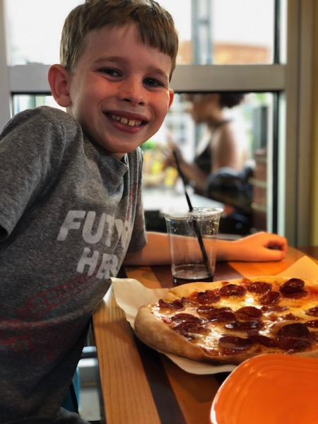 kid eating pizza at Northstar Cafe Easton Town Center