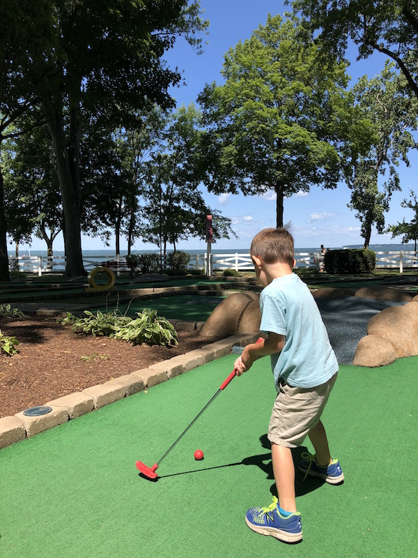 boy playing mini golf in lakeside ohio