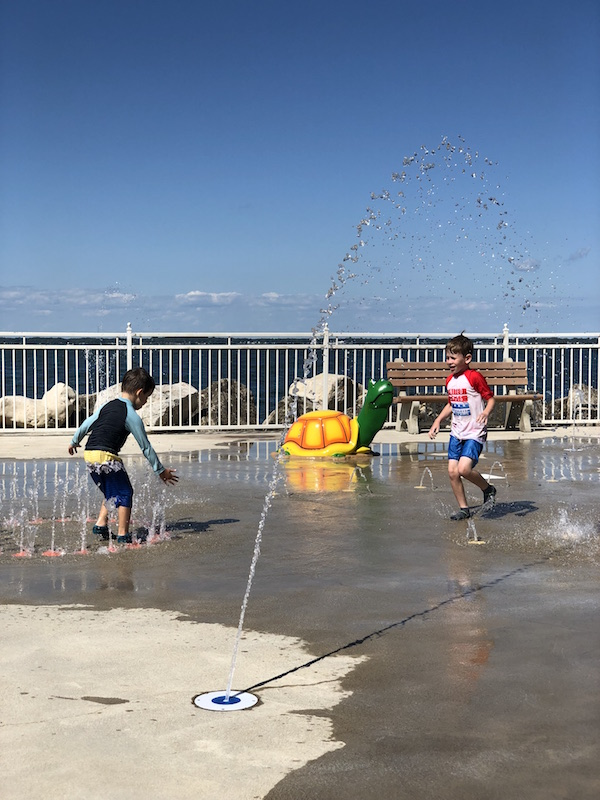 boys playing in splash pad in Lakeside Ohio