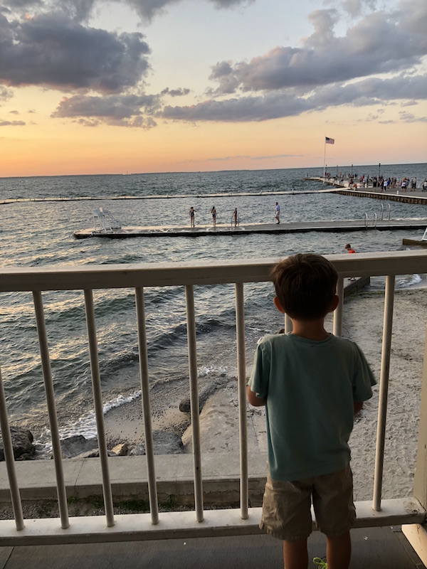 boy watching the sun set at lakeside Ohio