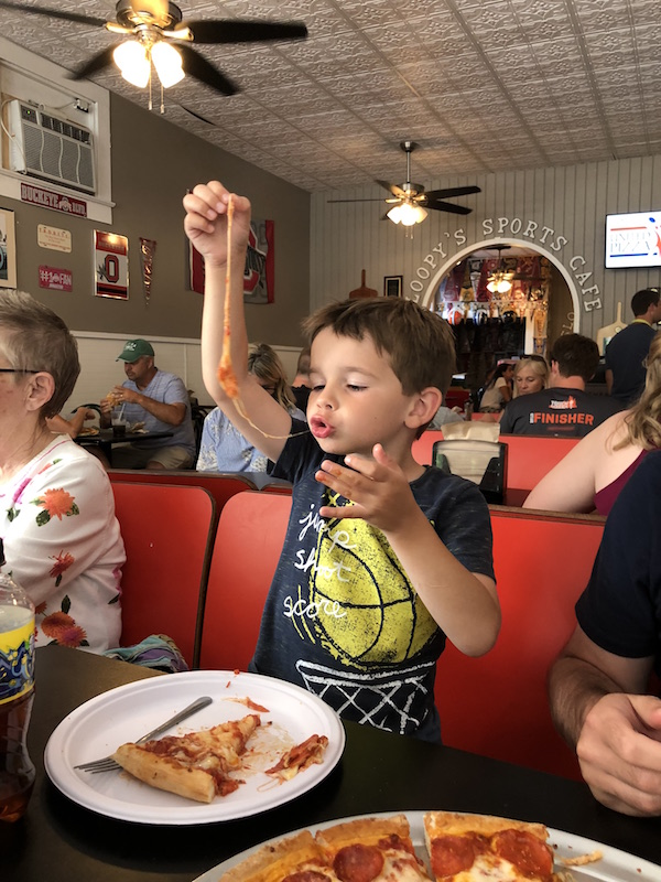 boy eating pizza at Sloopy's Cafe in Lakeside, Ohio