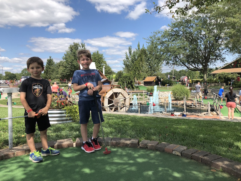 boys playing mini golf at Young's Jersey Dairy in Yellow Springs Ohio