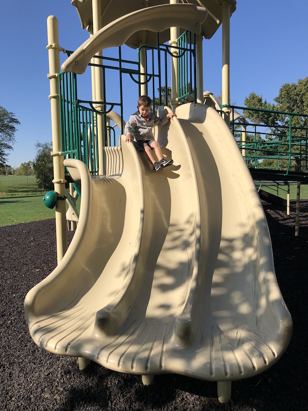 boy on slide at park in dublin ohio
