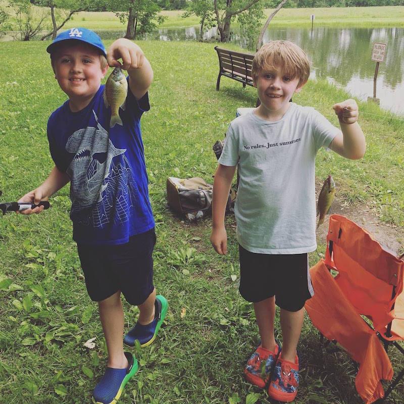 boys holding a fish at Blackridge Community Park