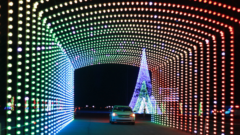Car driving through a tunnel of lights at WonderLight's Christmas in Ohio light show