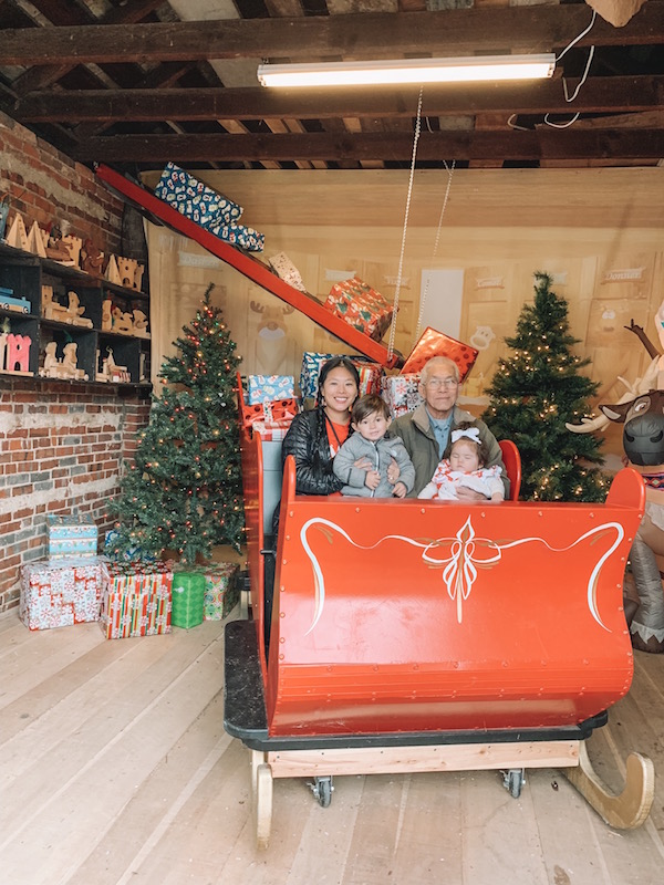 family in a sleigh at Snowflake Castle in Westerville, Ohio